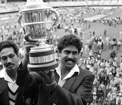 Kapil Dev with the 1983 Prudential Trophy