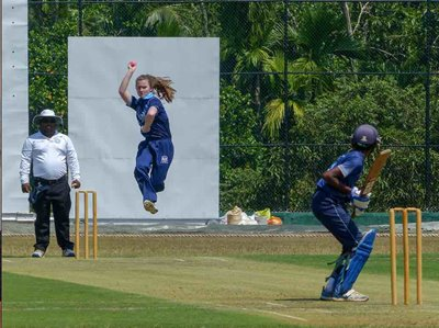 Gloucestershire seamer Maddie Hughes bowls during a game against Wadduwa Central College