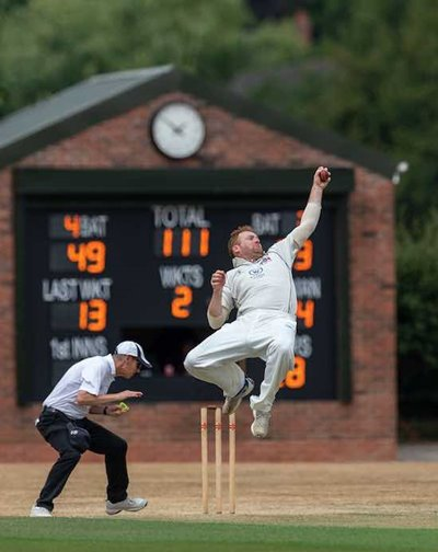Stuart Burrows of Tamworth 1st XI clings on to a return catch
