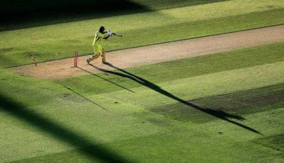 Australia's Glenn Maxwell is bowled by England's Chris Jordan