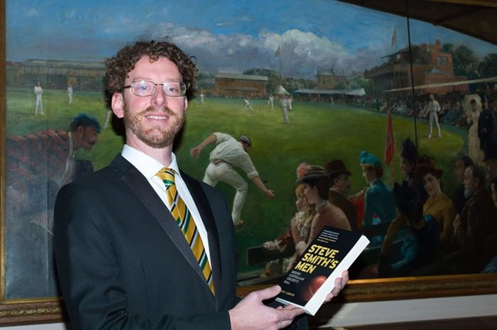 Geoff Lemon poses with his book.