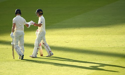 Rory Burns and Jack Leach leave the field after Day 1.